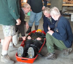 Wairarapa Search and Rescue team members load a `victim' on to a chopper during training.